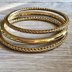 Triple gold toned Ralph Lauren bangle bracelets